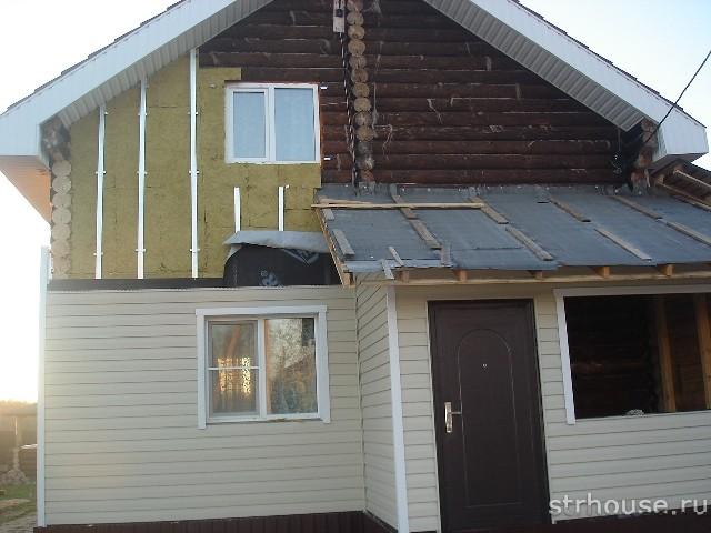 Обшивка дома из бревна сайдингом