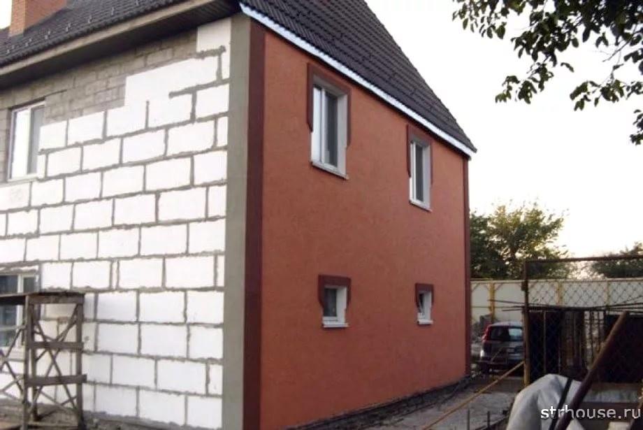 Оштукатуренный дом из газобетона